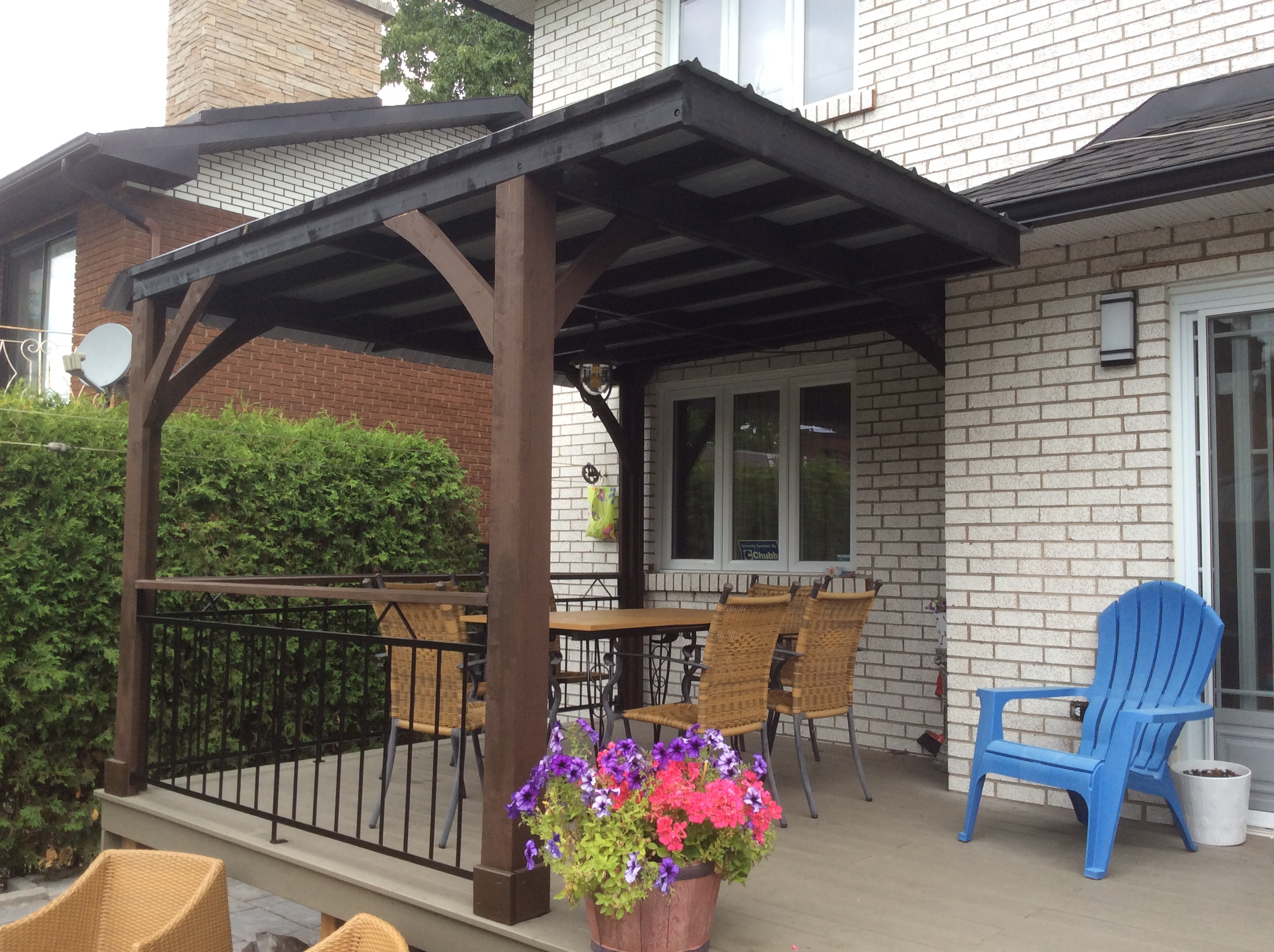 Custom sun shelters for high patio on a slope.